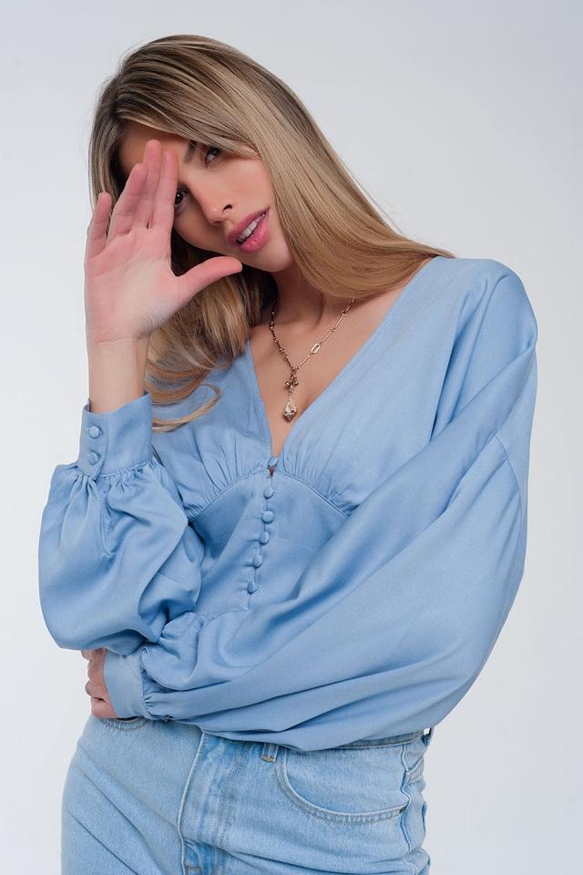 Top met pofmouwen in blauw