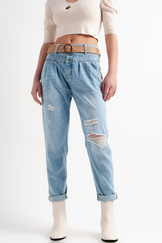 Drop crotch jeans in vintage light wash blue with rips