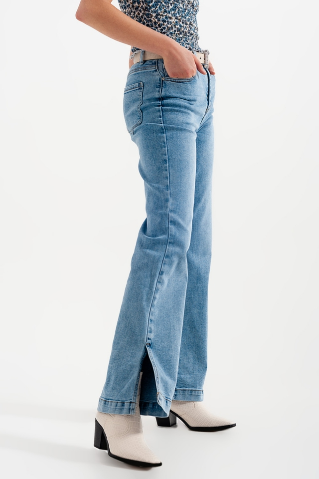 High waisted flared jeans with side slits washed blue