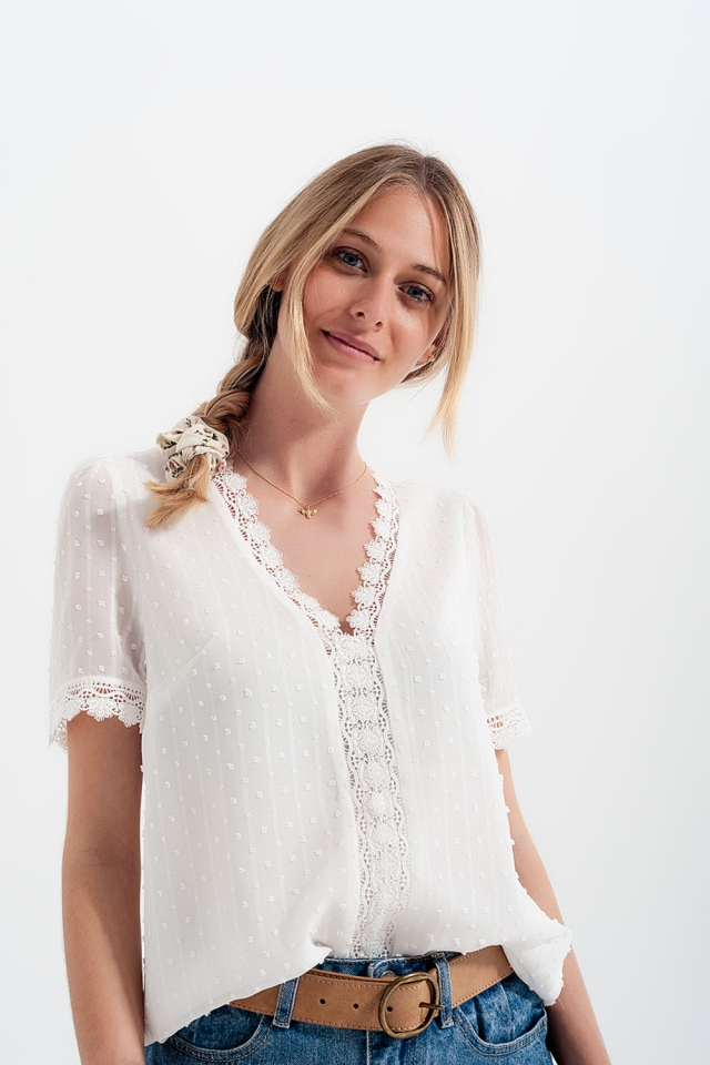 Top with V neck and lace trim detail in white