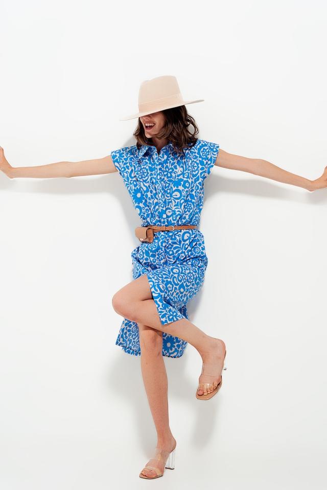 Sleeveless cotton dress in a light blue bold floral print