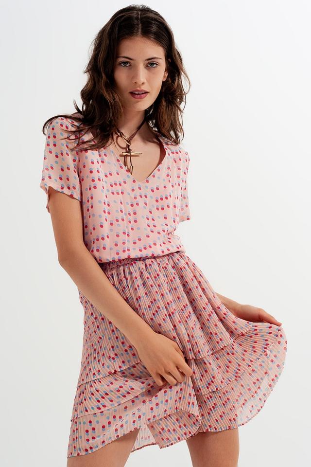 Shirred mini dress with peplum in pink