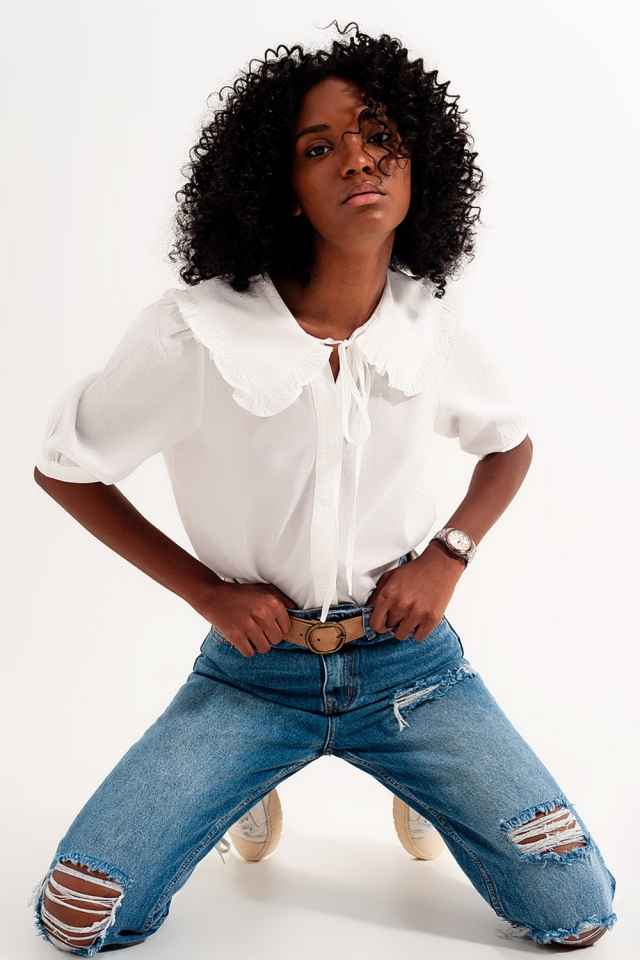 High rise slim mom jeans in midwash with rips