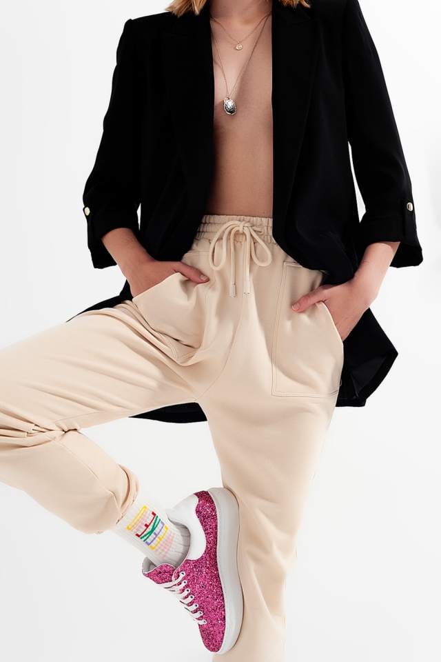 Joggers with elastic waist band in beige