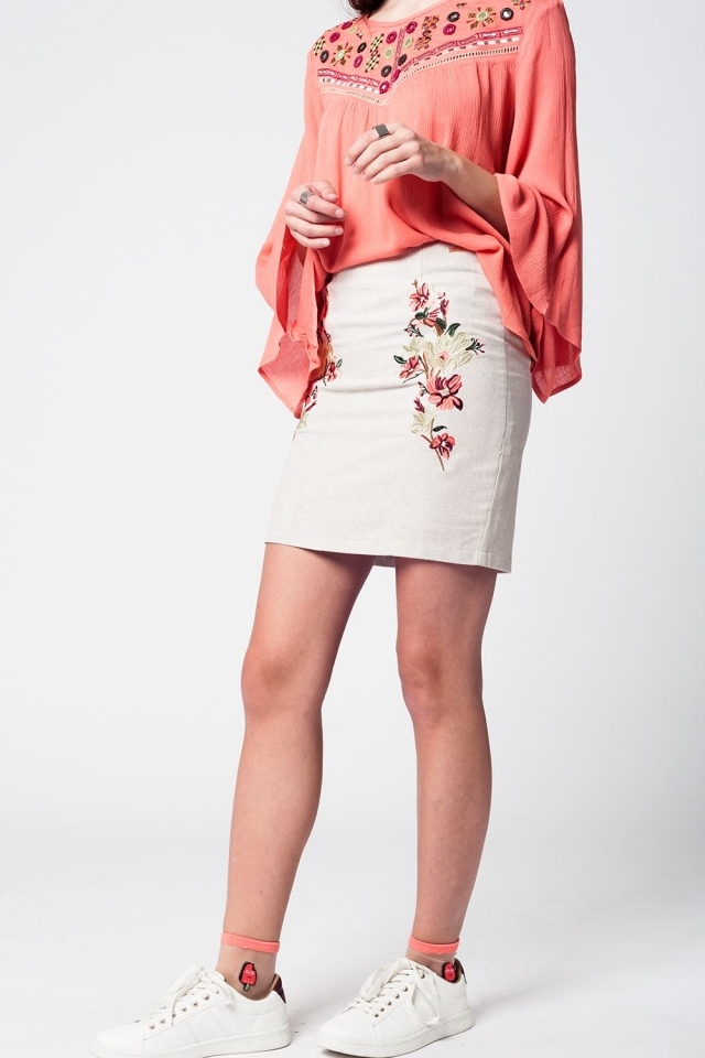 Mini beige linen skirt with floral embroidery on the front