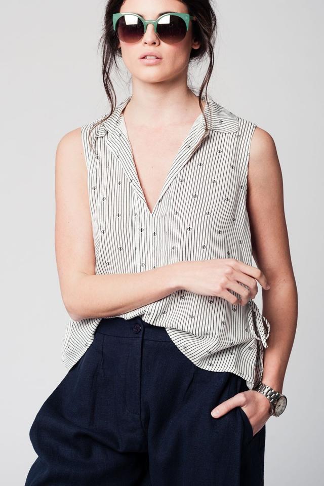 Black no sleeve V neck blouse with navy sailor design