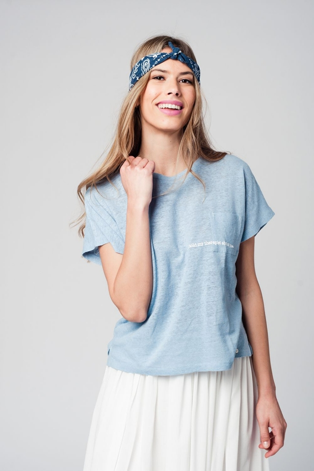 Blue t-shirt with text and pocket at the front