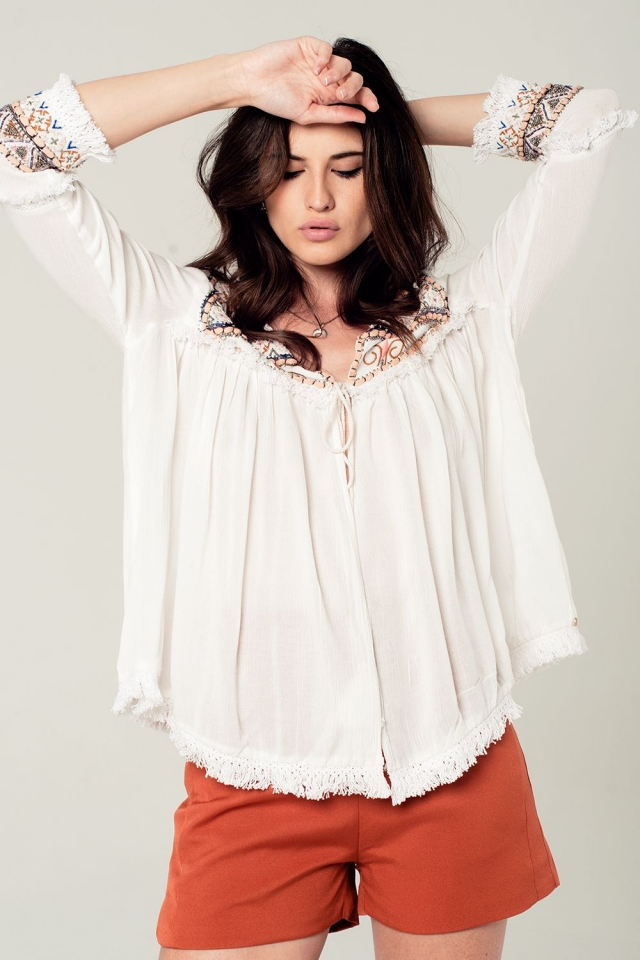 Embroidered white jacket with fringed detailing