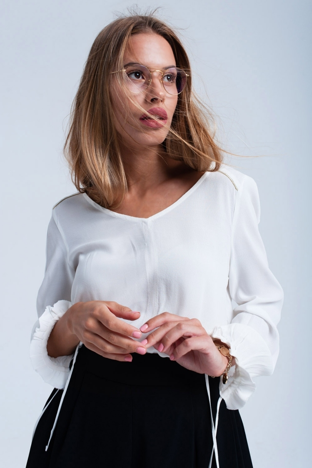 White flowing blouse