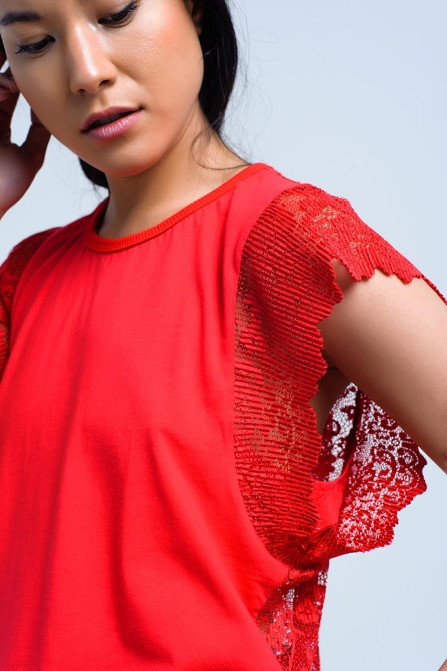 Red top with lace back and ruffles