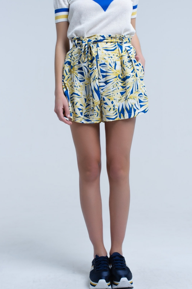 Yellow shorts with leaf print