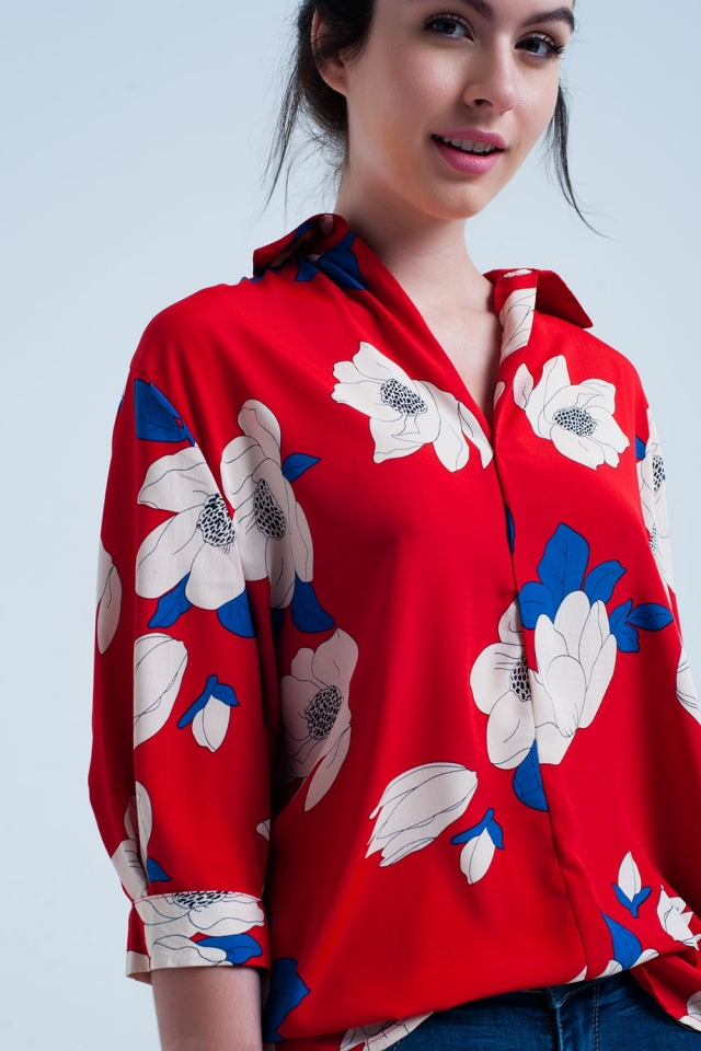 Red shirt with large printed flowers