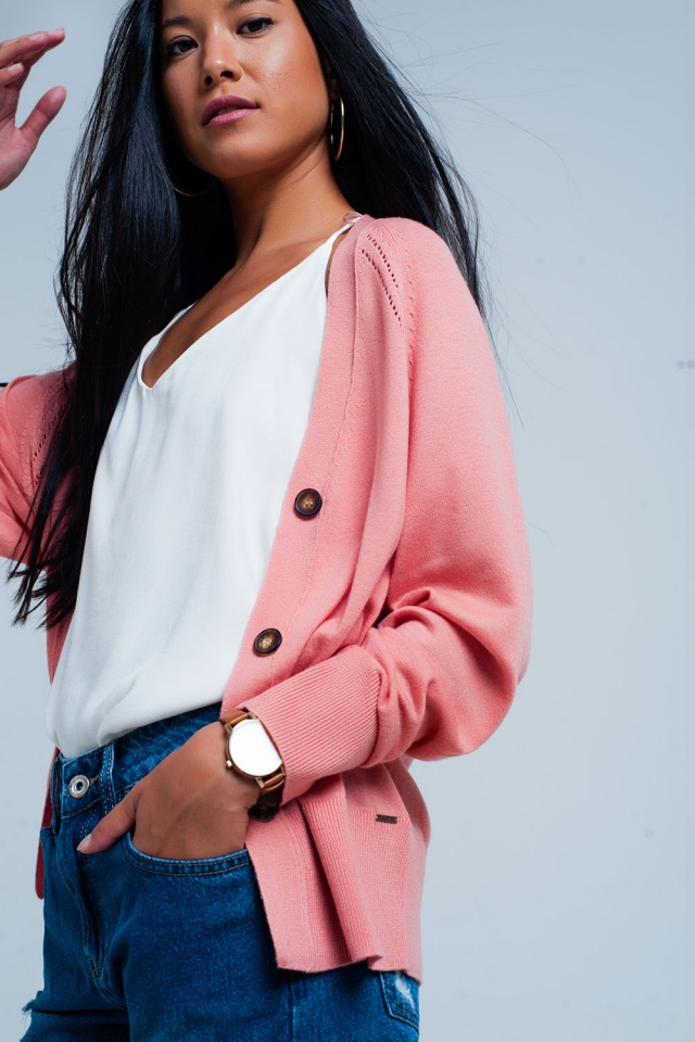 Pink cardigan with buttons and edgy seam
