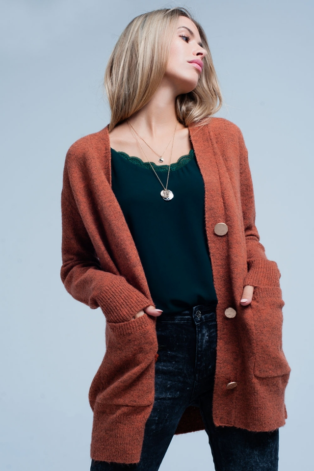 Orange cardigan with gold buttons