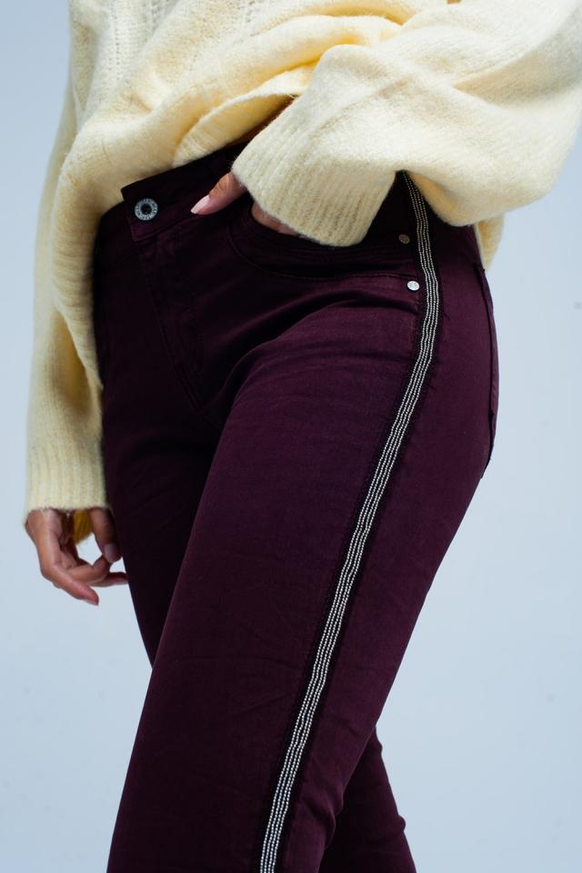 Bordeaux skinny jeans with metal side stripe