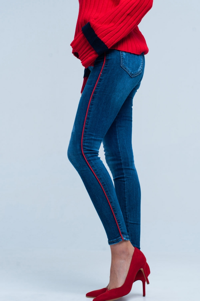 Blue skinny jeans with red side stripe