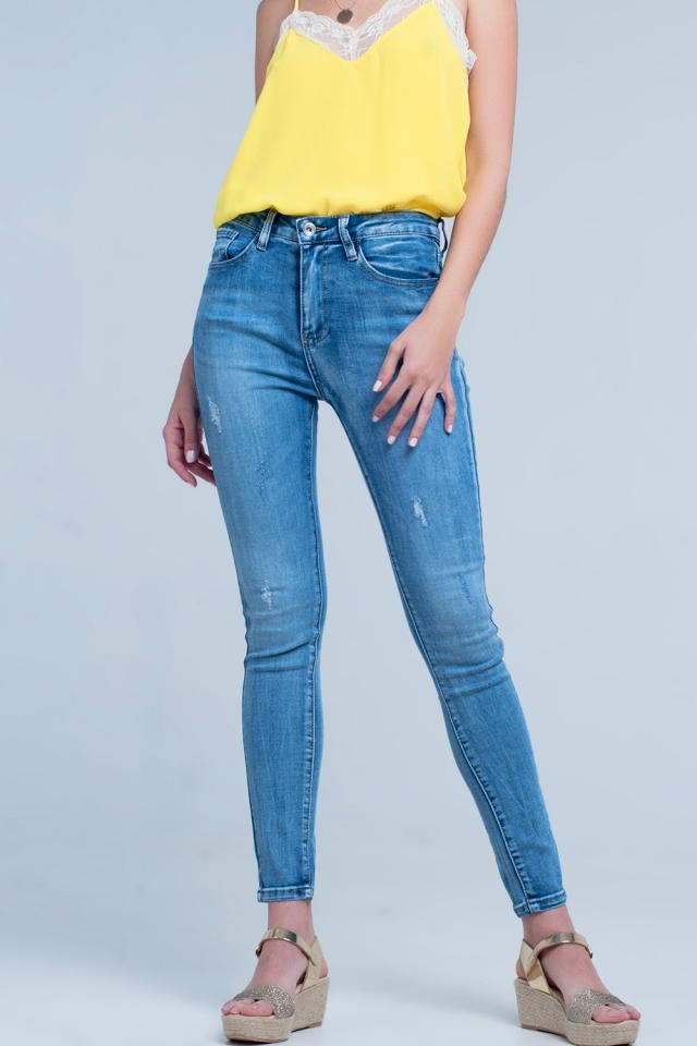Mid wash distressed denim jeans