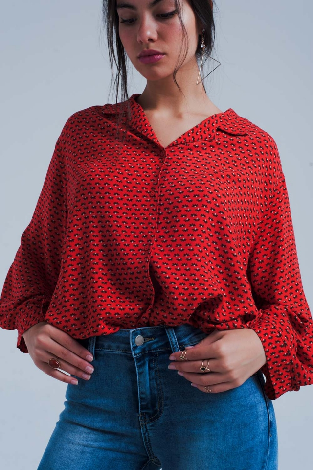 Red blouse with black flower print