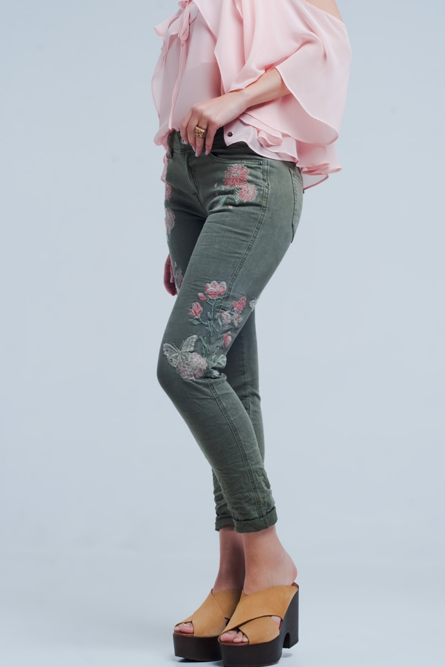 Khaki jeans with embroidered flower
