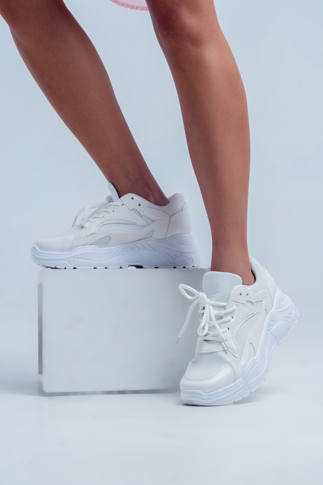 White sneakers with low platform