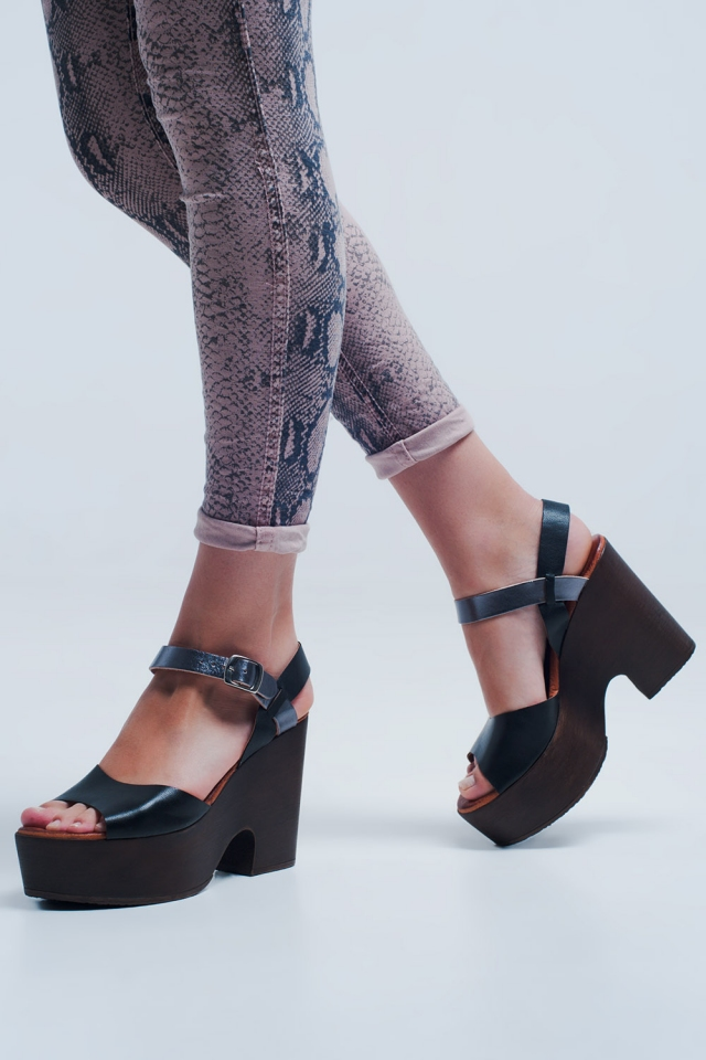 High heels with black coloured straps