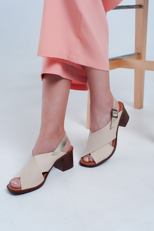 Heeled sandals with cross strap in beige