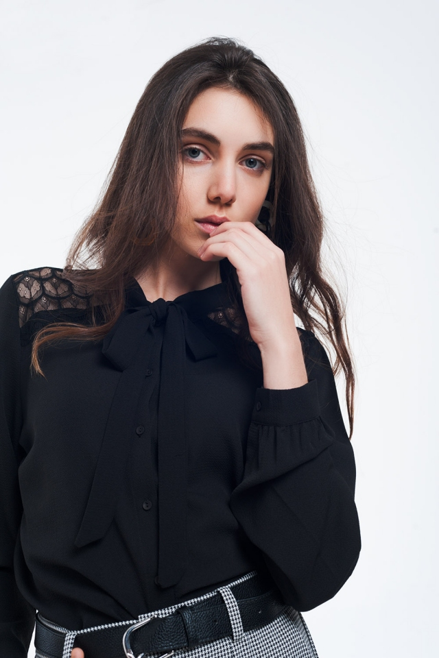Black button-down shirt with lace detail