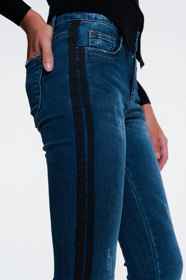 Jeans with distressing and side stripe