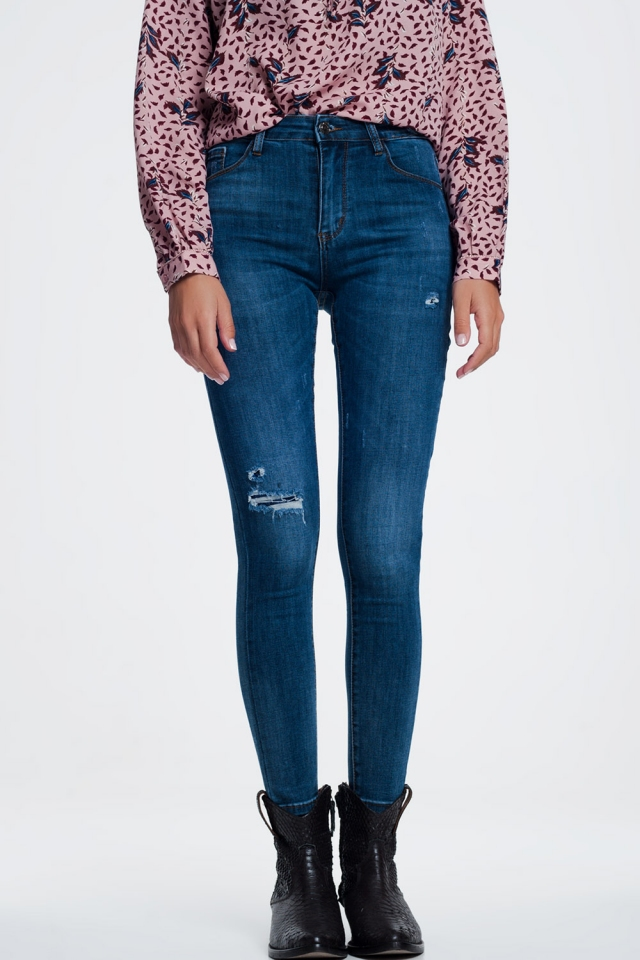 Ripped skinny jeans in blue denim