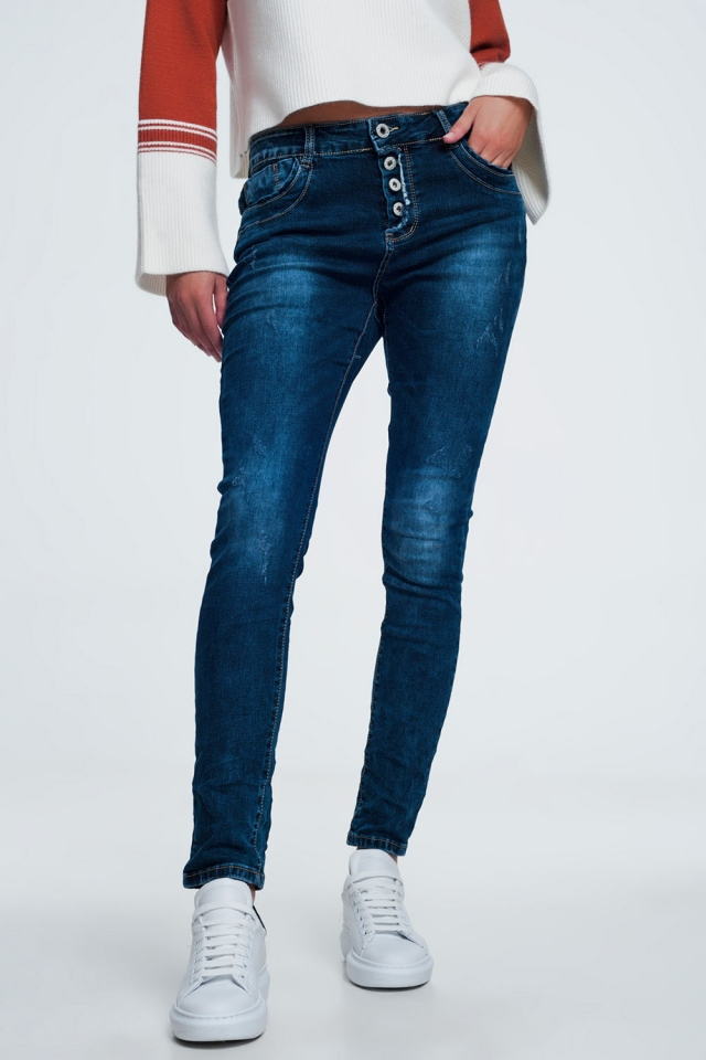 Blue jeans with button closure