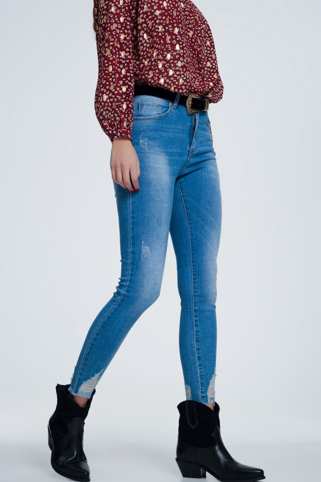 Super skinny jeans with wear detail and cut in ankles