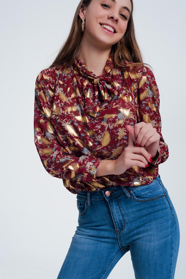 Red shirt with golden shiny feather print