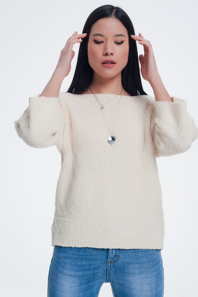 cream coloured sweater with knitted patterns