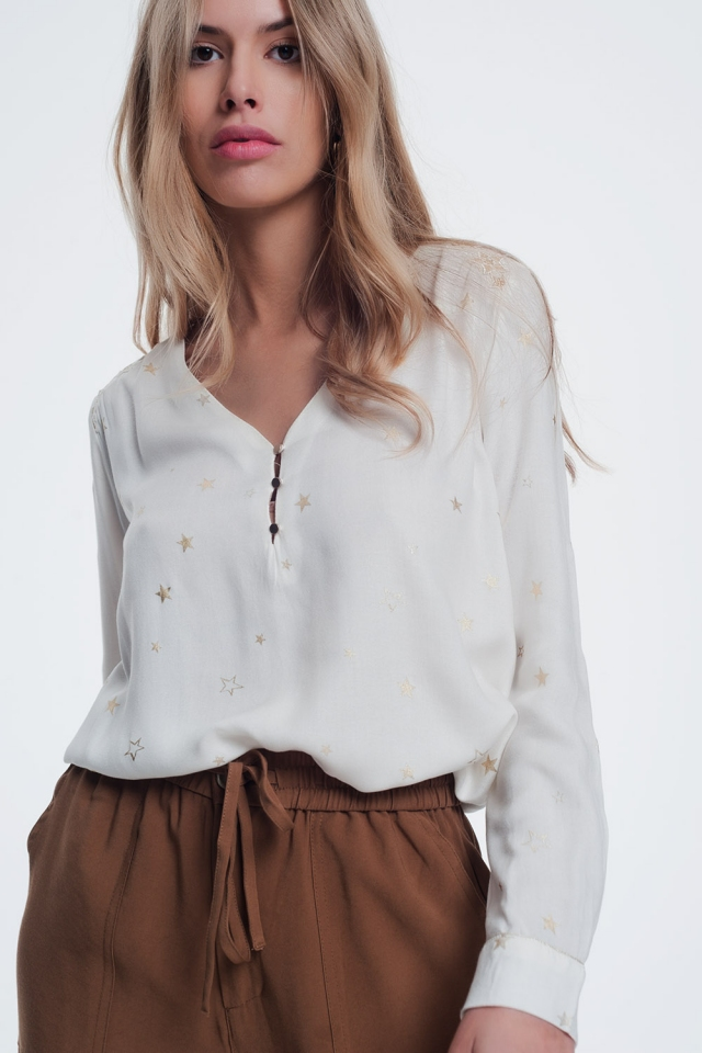 cream blouse with stars print
