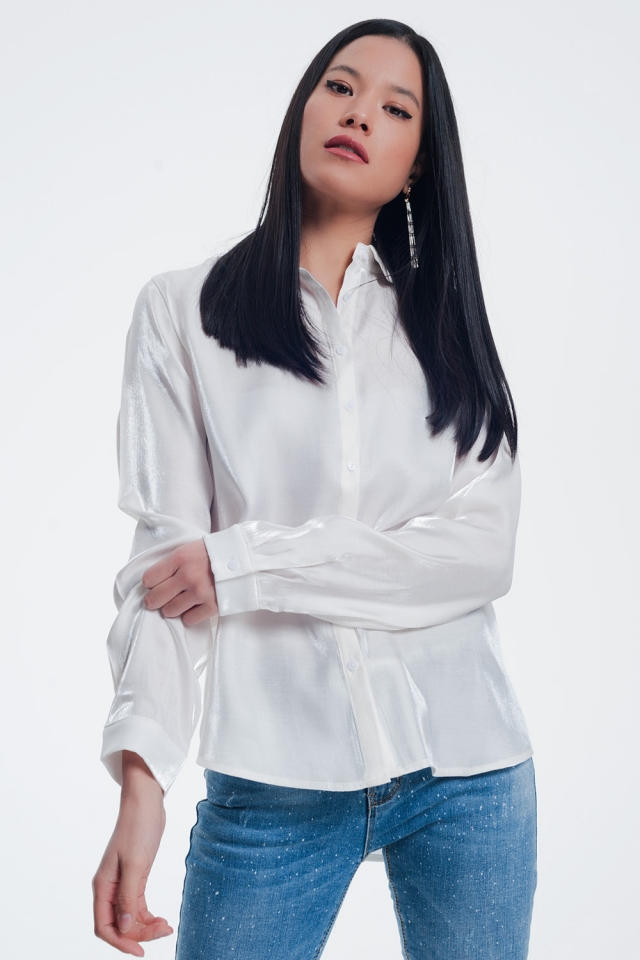 White shiny blouse with long sleeves