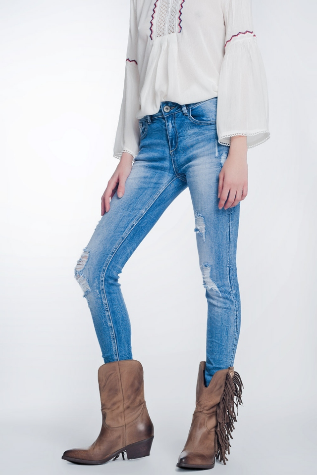 super skinny jeans in vintage mid wash blue with heavy rips